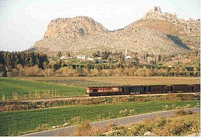 Yilankale provides a backdrop for an Adana bound freight note loco long hood forward. Photo Malcolm Peakman 1998