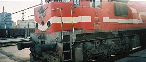 The cab end and bogie of DE22001. This close up pictures shows the TCDD logo on the nose of the engine. This deco seems to be specific to this particular unit. July 2001. photo Gökçe Aydın